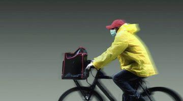 Masked Man on Bicycle