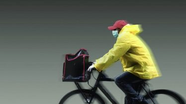 Masked Man on Bicycle